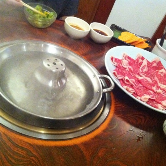 Photo taken at Shabu-Tatsu by Gabriel D. on 6/20/2011