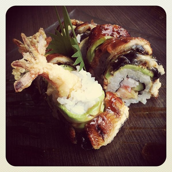 Photo taken at YASASHII Japanese Fusion Cuisine by Parvit S. on 2/2/2012