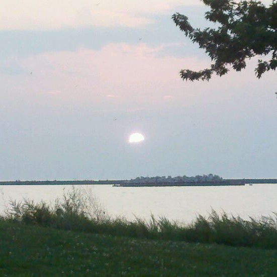 Photo taken at Whiskey Island Volleyball Courts by Rick F. on 8/31/2011
