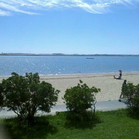 Photo taken at Constitution Beach by Lauren S. on 9/10/2011