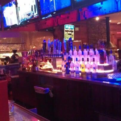 Photo taken at Smokey Bones Bar & Fire Grill by Tc D. on 8/13/2012