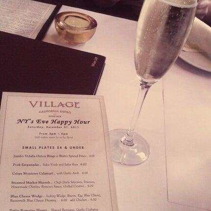 Photo taken at Village California Bistro & Wine Bar by Anna V. on 1/1/2012