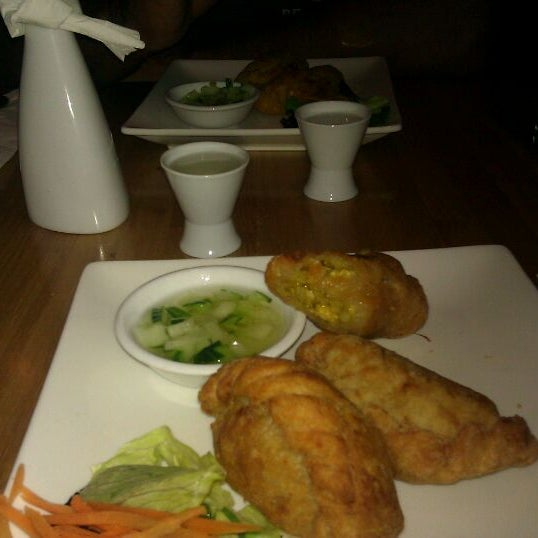 Photo taken at Nahm Thai Kitchen by Mina V. on 11/28/2011