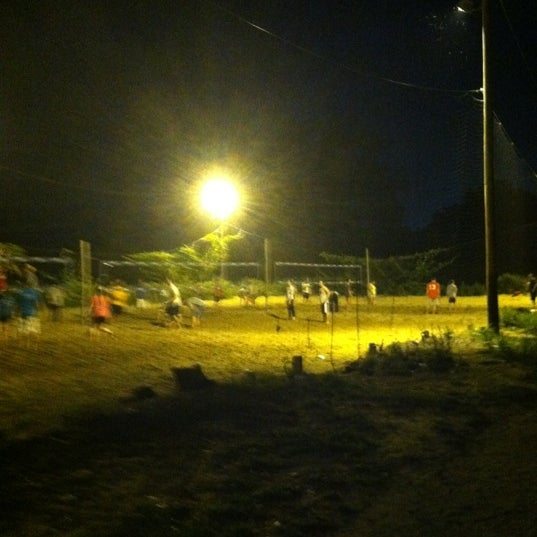 Photo taken at Whiskey Island Volleyball Courts by Kim on 8/31/2012