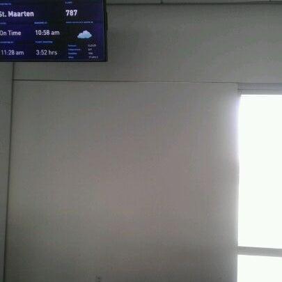 Photo taken at Gate 20 by Jason P. on 12/10/2011