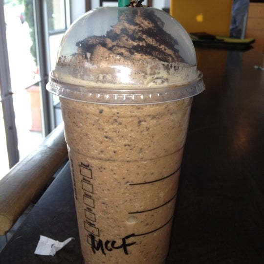 Photo taken at Starbucks by Kim L. on 5/25/2012