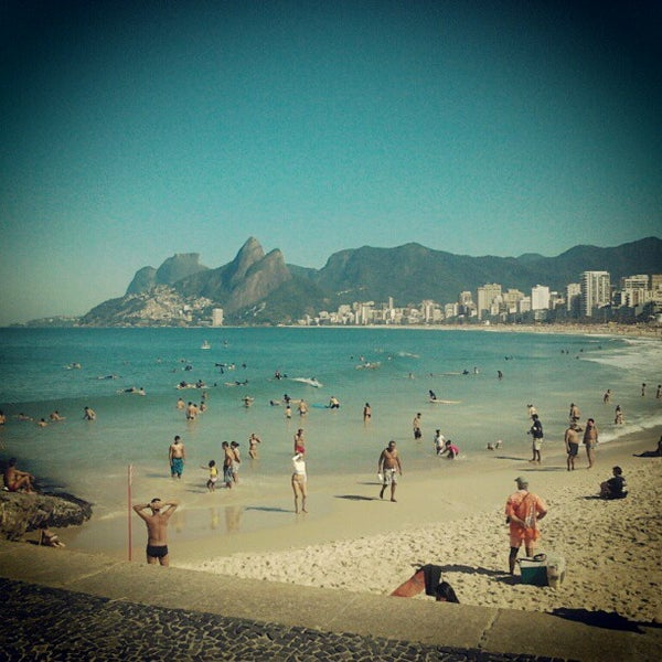 Photo taken at Praia de Ipanema by Marcelo M. on 8/12/2012