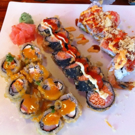 Photo taken at Sushi Cafe by Kadi D. on 9/16/2011
