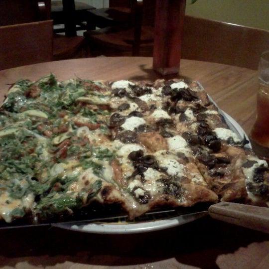 Photo taken at Joe Squared Pizza & Bar by Samantha L. on 11/20/2011