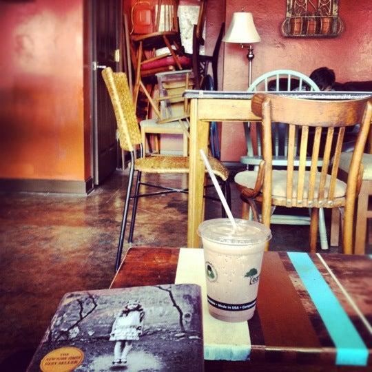 Photo taken at Rivertown Coffee by Lauren H. on 7/17/2012