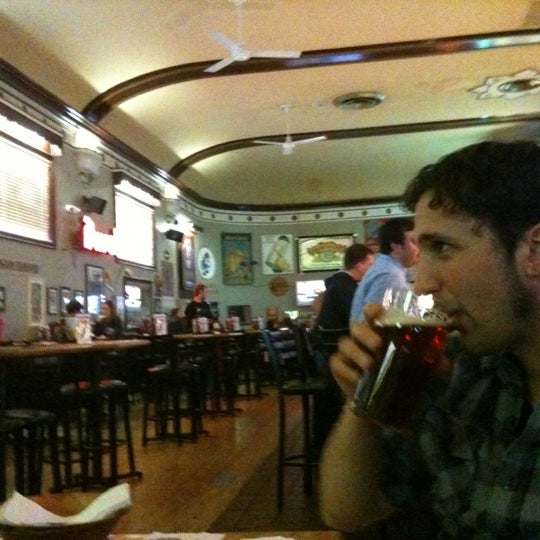 Photo taken at Winking Lizard Tavern by Katherine B. on 3/27/2012