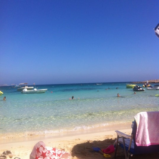 Photo taken at Makronissos beach by Antonis M. on 8/14/2012