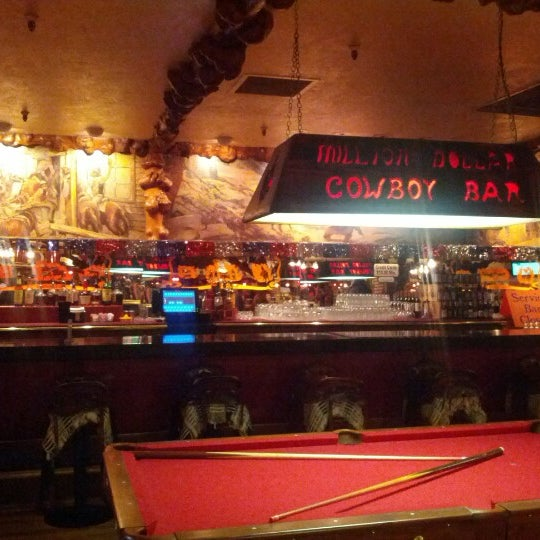 Photo taken at Million Dollar Cowboy Bar by David W. on 7/5/2012