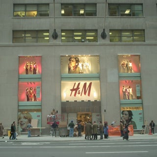 Photo taken at H&M by Lucky Magazine on 12/9/2011