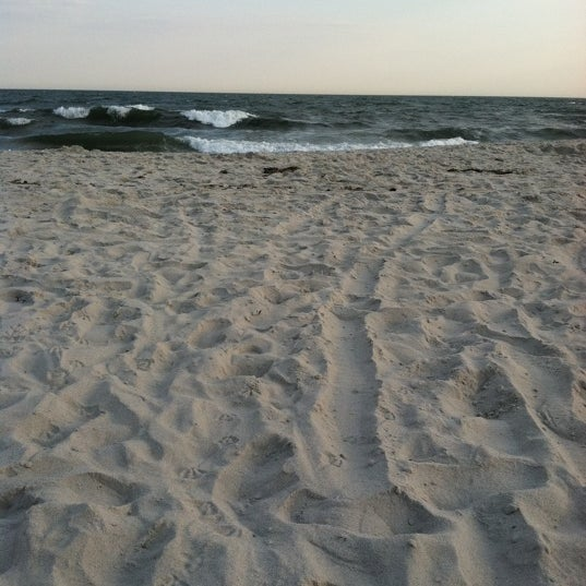 Photo taken at East Atlantic Beach by Hallie S. on 7/16/2011