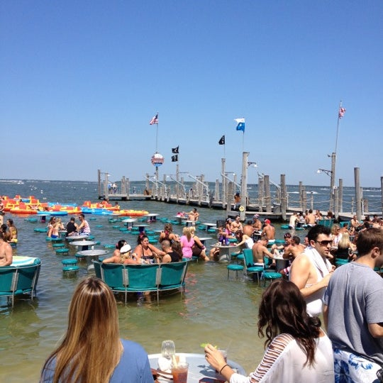 Photo taken at Seacrets by Kathryn K. on 7/4/2012