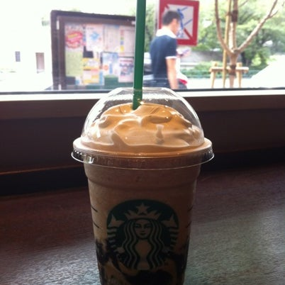 Photo taken at Starbucks Coffee 神楽坂下店 by marie claire f. on 8/4/2012