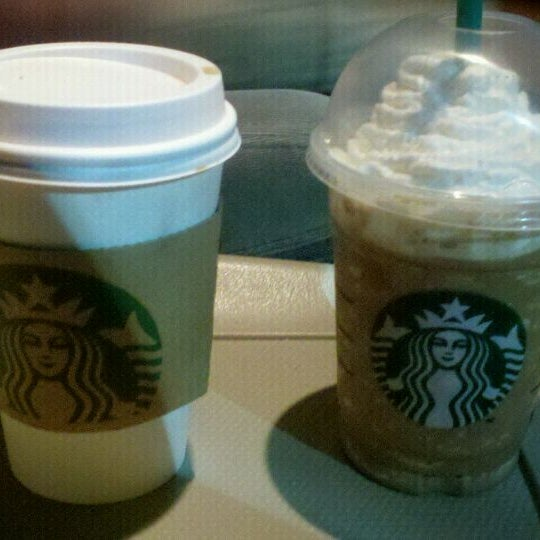 Photo taken at Starbucks by Crystal S. on 3/25/2012