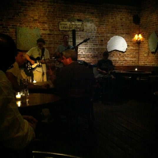 Photo taken at 11th Street Bar by Becky C. on 6/28/2012