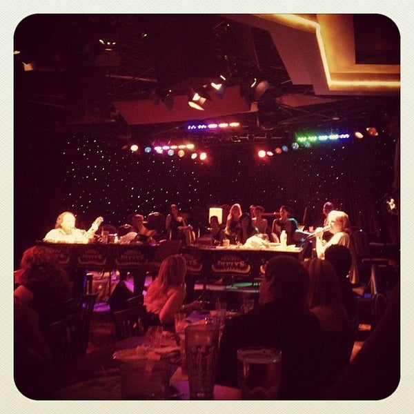Photo taken at Bogart's Place by Jenny P. on 7/29/2012