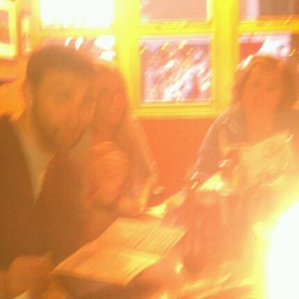 Photo taken at Ugly Oyster Drafthaus by Justin W. on 2/28/2012