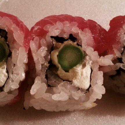 Photo taken at iSushi Cafe by Rod K. on 3/1/2012