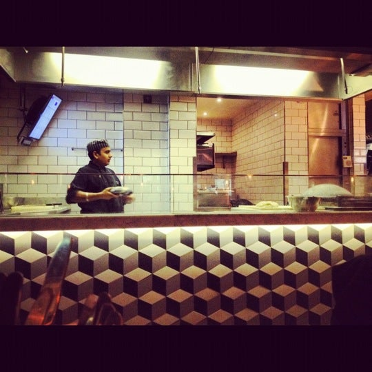 Photo taken at Dishoom by Cathy W. on 9/12/2012