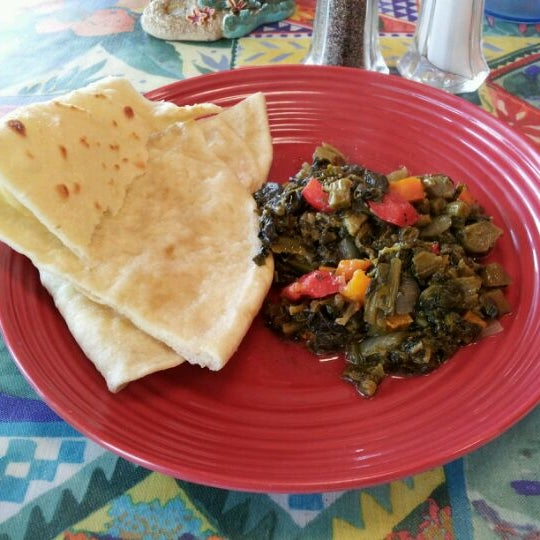 Photo taken at Mama Jamaica's Kitchen by Jim N. on 3/20/2012