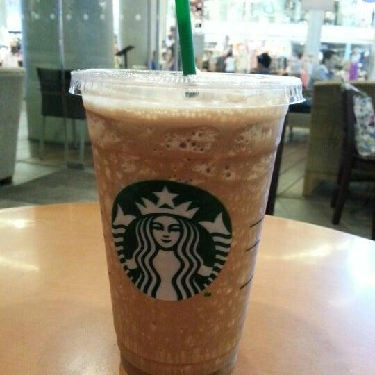 Photo taken at Starbucks by OneSi@M on 9/13/2012