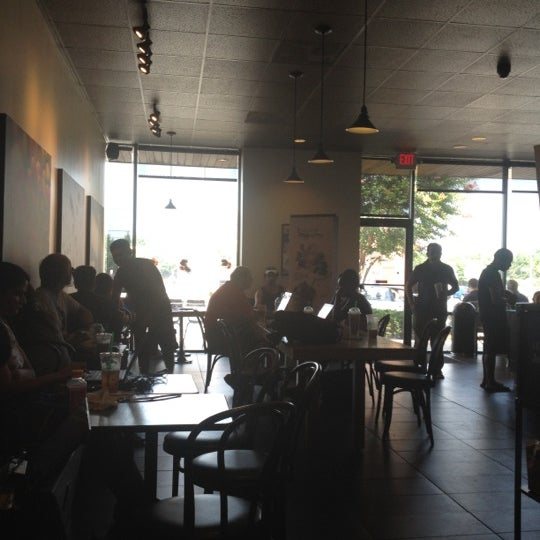 Photo taken at Starbucks by Erdem O. on 7/4/2012