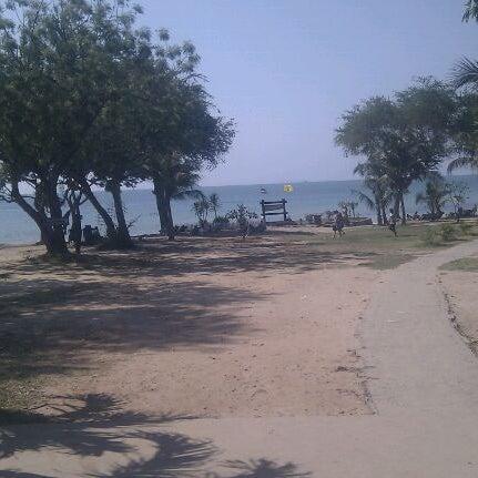 Photo taken at Sai Keaw Beach by Eva T. on 3/17/2012