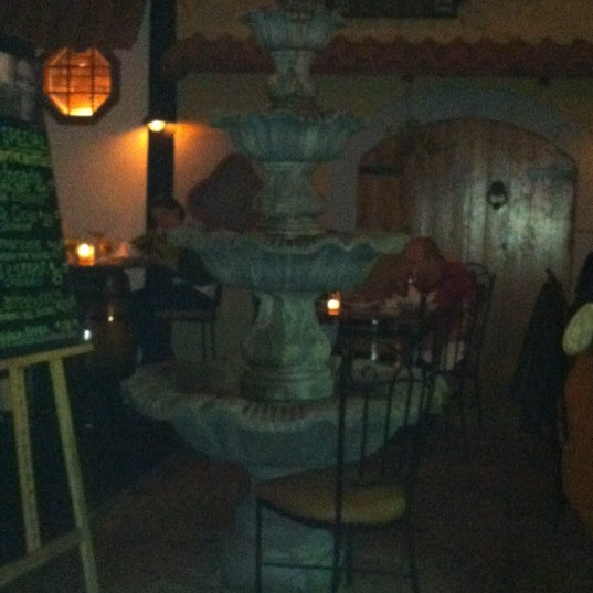 Photo taken at Lola Tapas & Wine Bar by Lauren S. on 4/21/2012