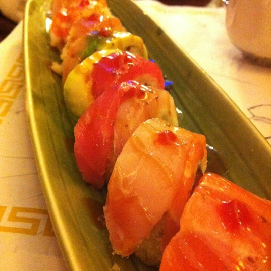 Photo taken at Sushi Tomo by Derek Y. on 3/15/2012