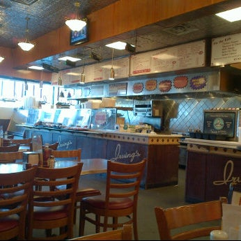 Photo taken at Irving's Delicatessen by Ashley O. on 2/26/2012