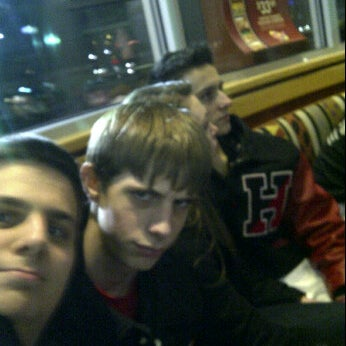 Photo taken at Red Robin Gourmet Burgers by AJ C. on 3/4/2012