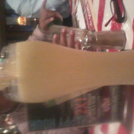 Photo taken at TGI Friday's by Alexandra C. on 6/19/2012