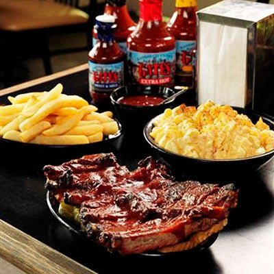 Photo taken at Gates Bar-B-Q by Southern Living on 2/10/2012