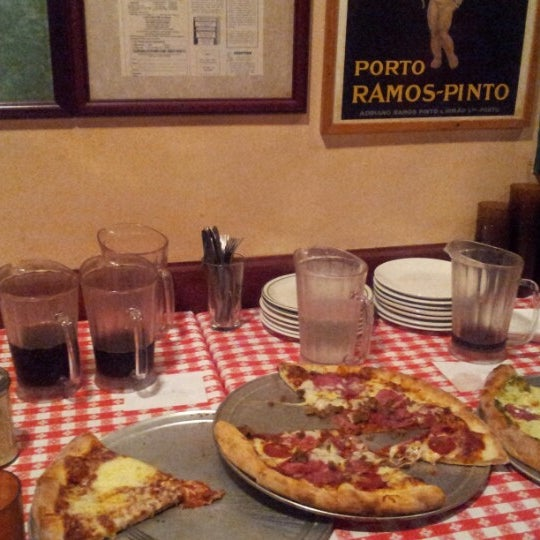 Photo taken at Milano Pizzeria by Christopher D. on 7/15/2012