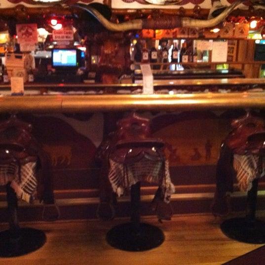 Photo taken at Million Dollar Cowboy Bar by Jami P. on 8/15/2012