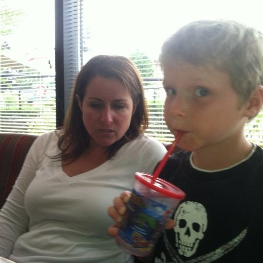 Photo taken at Red Robin Gourmet Burgers by Jamie T. on 7/22/2012