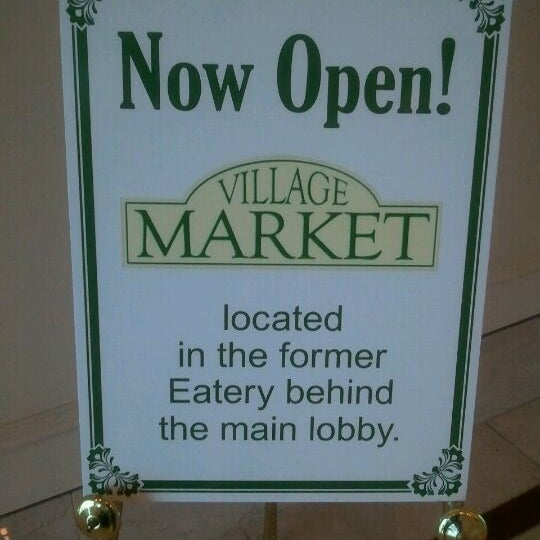 Photo taken at Village Market (Lobby Level) by Arnaldo R. on 4/13/2012