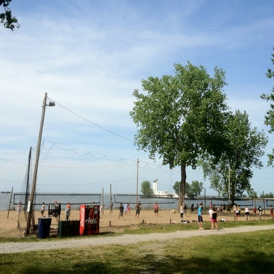 Photo taken at Whiskey Island Volleyball Courts by Tim B. on 5/20/2012