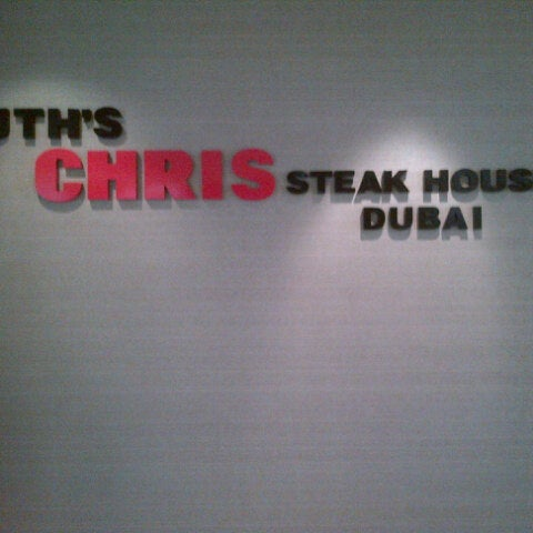 Photo taken at Ruth's Chris Steak House by Andrew B. on 8/8/2012