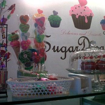 Photo taken at Sugar Blossom by Yanin G. on 5/17/2012