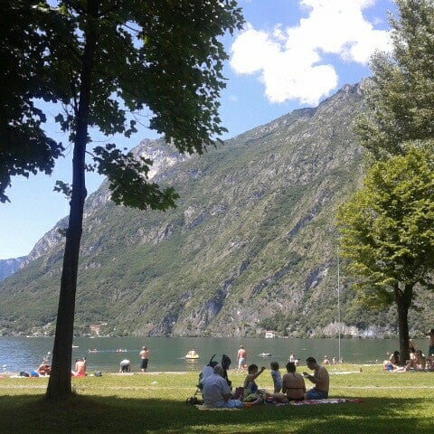 Photo taken at Lago di Lugano by Myriam R. on 7/15/2012