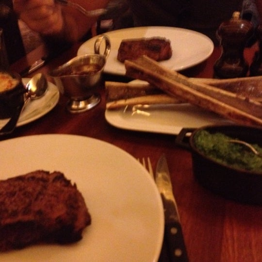 Photo taken at Hawksmoor Seven Dials by Randa K. on 7/30/2012
