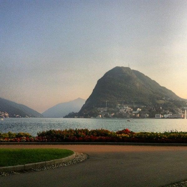 Photo taken at Lago di Lugano by Olga B. on 9/9/2012