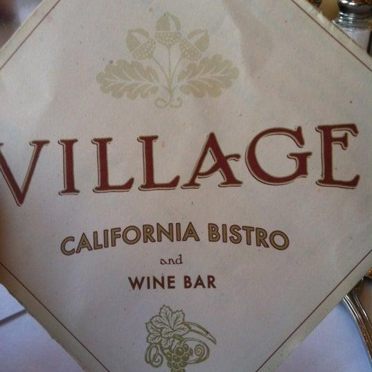 Photo taken at Village California Bistro & Wine Bar by Lori T. on 3/10/2012