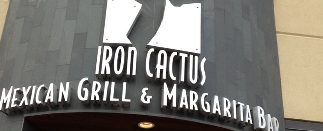 Photo taken at Iron Cactus Mexican Grill & Margarita Bar by Melanie W. on 5/25/2013