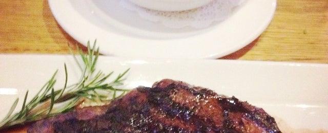 Photo taken at Grub Steak Restaurant by Adiel C. on 8/20/2012